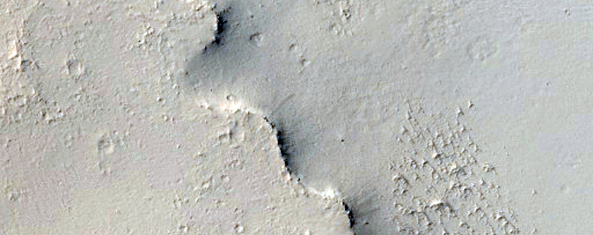 Small Crater with Cliff East of Henry Crater