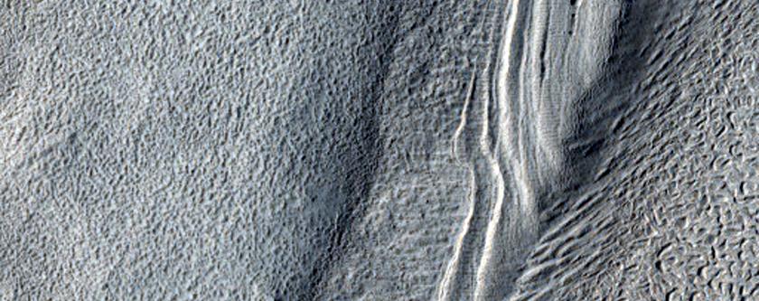Layered Features in Arabia Terra