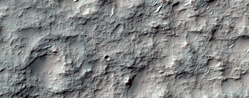 Basin and Channel Features in Terra Sirenum Intercrater Terrain