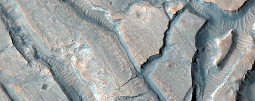Fractured Floor Materials within Crater in Arabia Terra