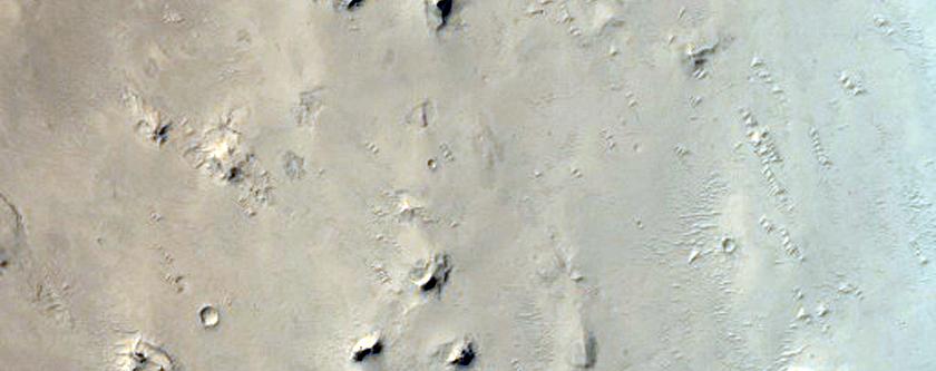 Layered Deposits and Dunes in Arabia Terra