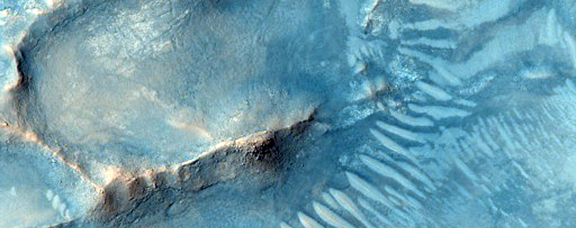 Low Albedo Spot in Northern Nili Fossae Crater