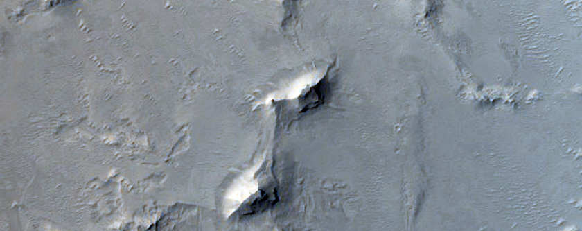 Layered Deposits and Dunes in Arabia Terra