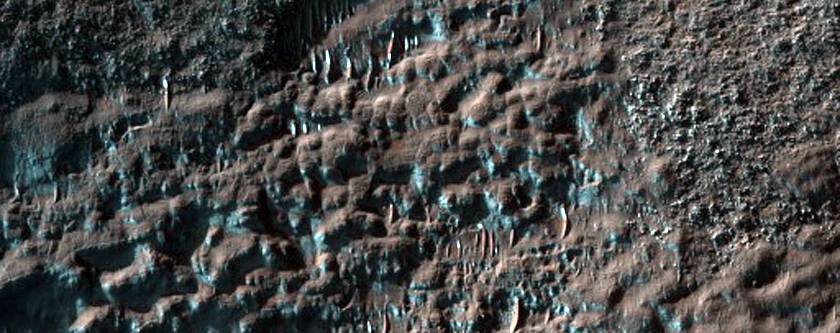 Dark Dunes and Ejecta in Kaiser Crater