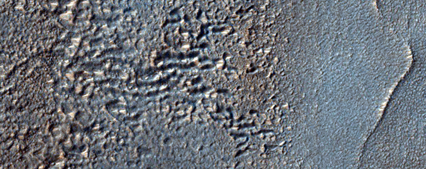 Remains of Layers along Wall of Crater South of Reull Vallis