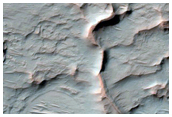 Sinuous Ridge with Mesa at Terminus in Kasabi Crater