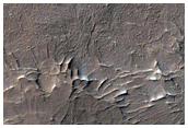 Layered Terrain and Crater Ejecta Deposits in Arabia Terra