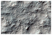 Basin and Channel Features in Terra Sirenum Intercrater Terrain