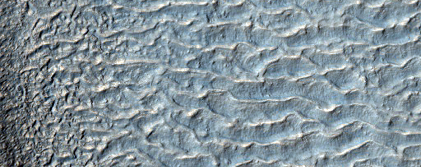 Dark-Toned Discontinuous Textured Surface Near Valley Termini