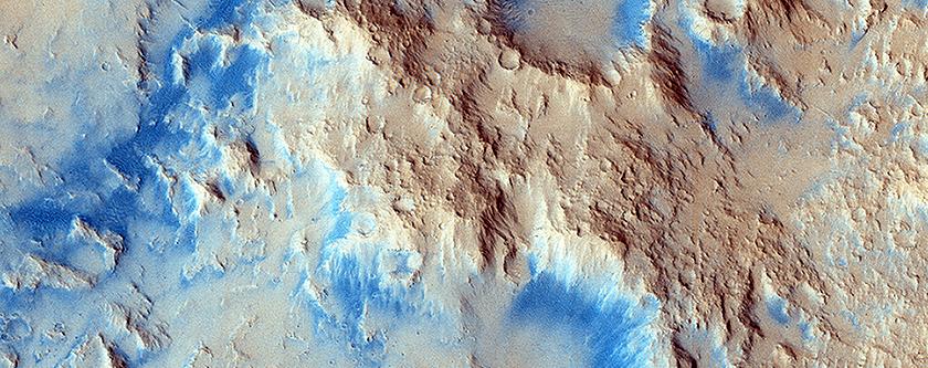 Sinuous Ridge Materials in Reuyl Crater