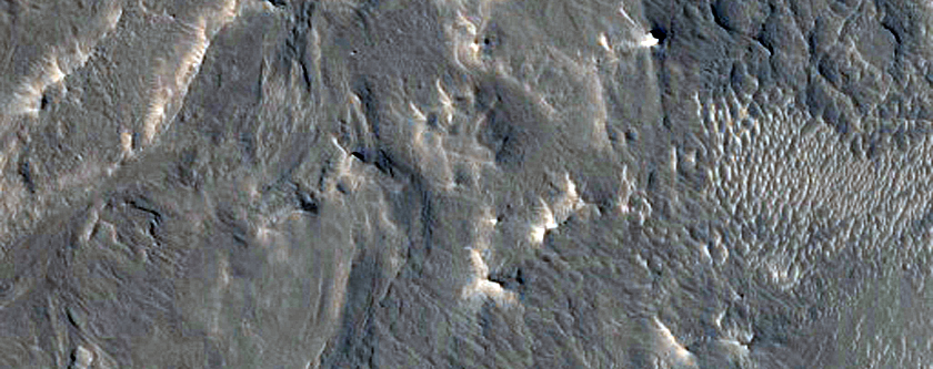 Channel Fill and Sinuous Ridge Material Southwest of Capen Crater