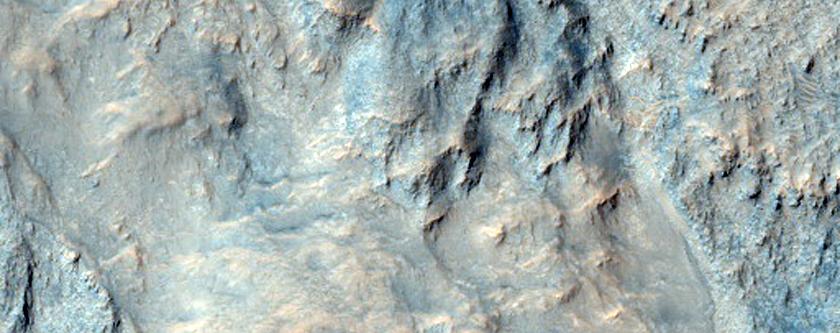 Possible Carbonate-Rich Terrain in Libya Montes