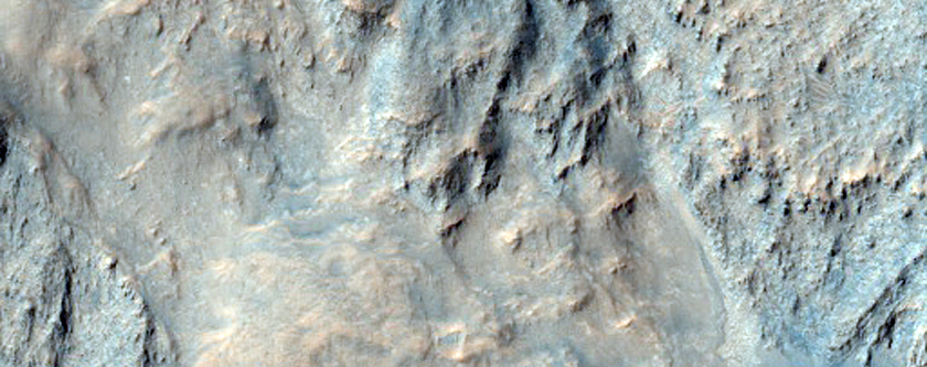 Possible Carbonate-Rich Terrain in Libya Montes