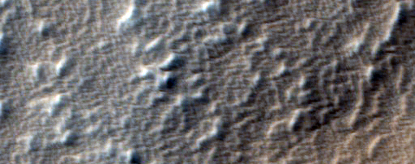 Impact Crater on Ridged Margin of Arsia Mons