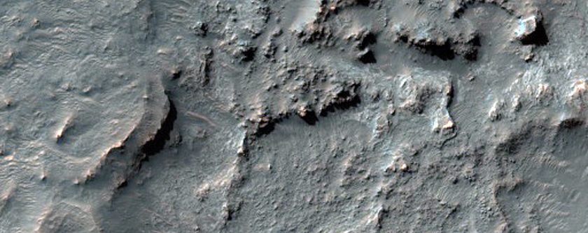 Curvilinear Ridges on Crater Floor Proximal to Its Southern Rim