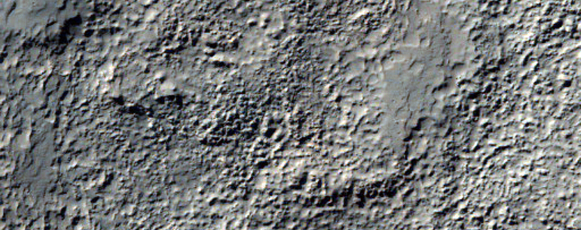 Intersection of Discontinuous Curvilinear Ridge and Wrinkle Ridge