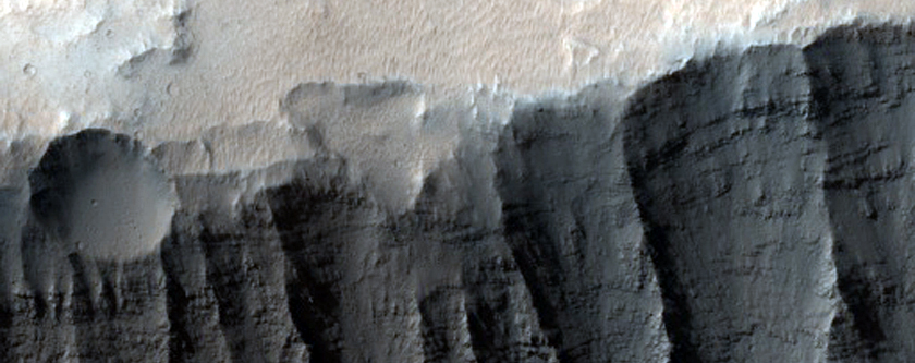 Crater on the Rim of Tithonium Chasma