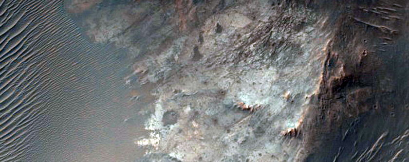 Possible Phyllosilicates Associated with Crater South of Aurorae Chaos