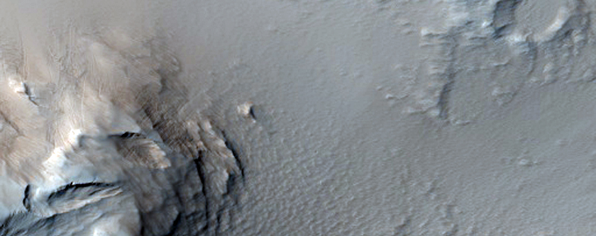 Cone-Like Structure Surrounded by Lava Flows in Tharsis Region