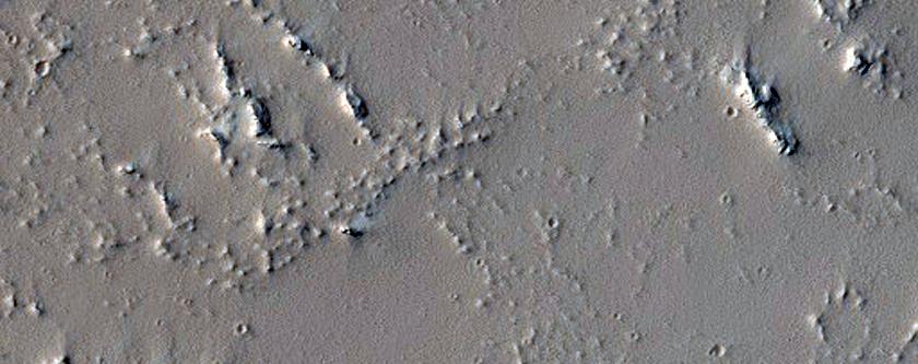 Noctis Fossae and Tharsis Region Lava Transition Region