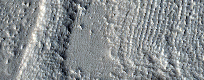 Channels and Crater Near Moreux and Rudaux Craters