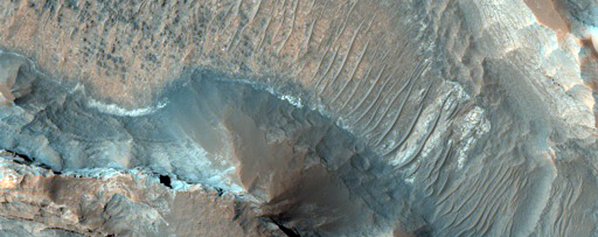 Colorful Layered Bedrock in Eroded Crater in Terra Sirenum