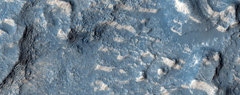 Contact between Ejecta from Large Crater and Surrounding Terrain