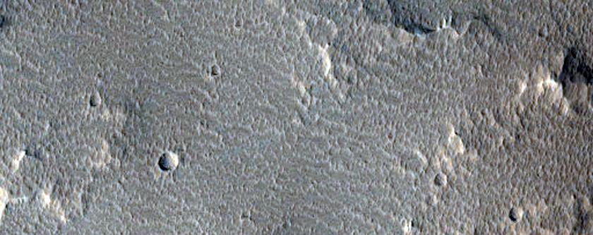 Crater on Rim of Tithonium Chasma