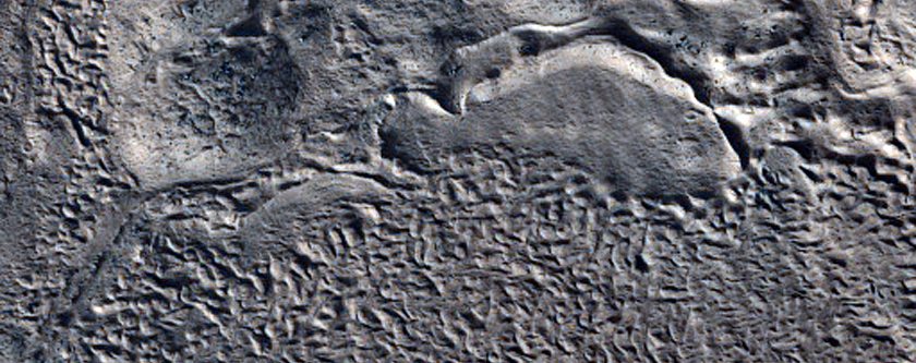 Streamlined Form on Impact Ejecta