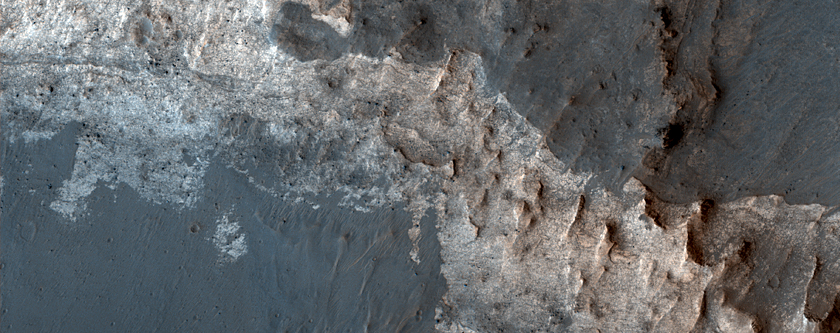 Light-Toned Hydrated Materials Inside Ius Chasma