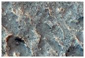 Pitted Surface around Crater in Idaeus Fossae Region