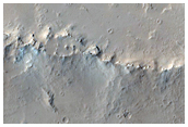 Pits Fissures and Channels East of Olympus Mons