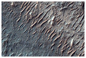 Mesa- and Butte-Forming Material in Circular Surface Feature