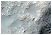Wrinkle Ridge and Channel Intersection along Huygens Crater Rim