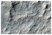 Yardang and Mesa-Forming Materials in Tyrrhena Terra