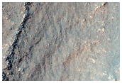 Layers in Irregular-Shaped Depression in Charitum Montes