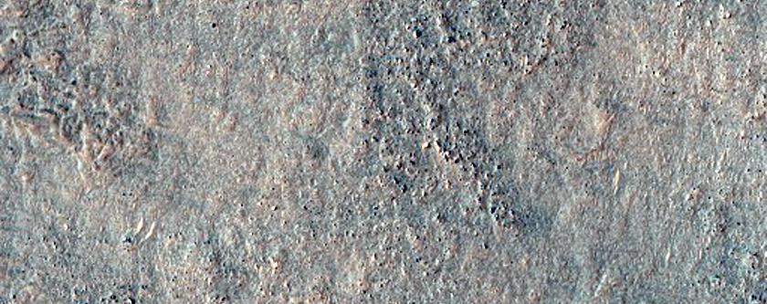 Curved Ridges Meeting Dark Plain