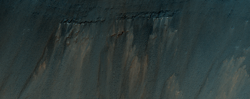 Stratified Material Beneath Crater on East Coprates Chasma Wall