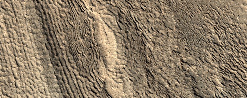 Ridges and Pits between Mounds in Phlegra Montes