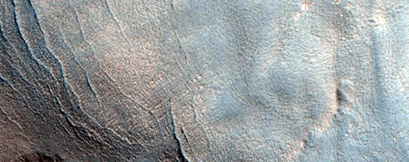 Pits in Valley on Rim of Moreux Crater