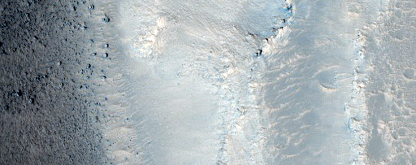 Streamlined Features and Fractures in Hebrus Valles