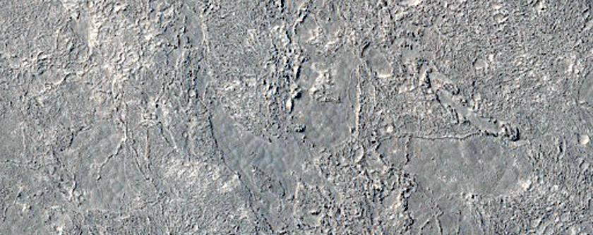 Saxorum liquefactorum crusta in Elysio Planitie ad occasum vergente