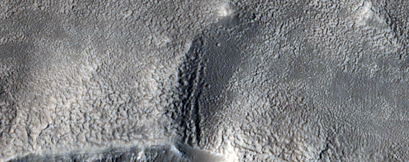 Two Exit Breaches in Young Crater