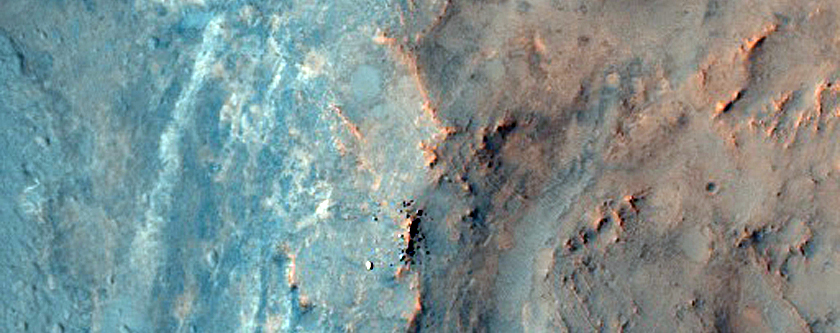 Layered Bedrock Exposed in Degraded Complex Crater in Nili Fossae