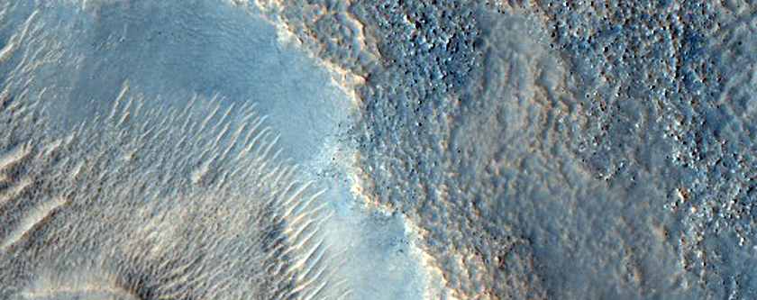 Dipping Layers in Crater and Depression in Deuteronilus Mensae