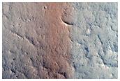 Pristine Small Crater with Wind Streak