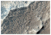 Diverse Compositional Stratigraphy in Claritas Region Rise