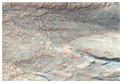 Eastern Portion of Gullied Impact Crater with Diverse Lithologies