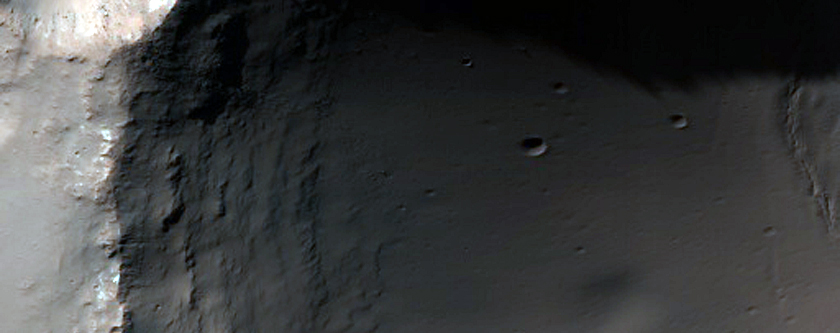 Possible Chloride Deposit Disrupted by Simple Crater