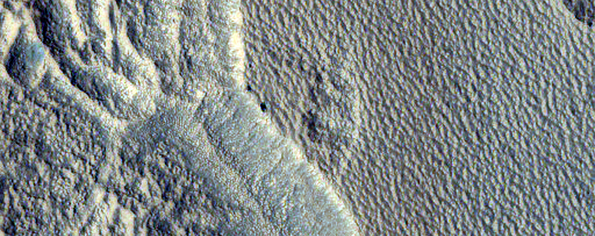 Pit in Milankovic Crater